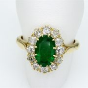 Oval Emerald Ring in 18 ct Yellow Gold with White Diamonds