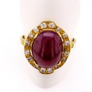 Oval Cabochon Ruby Ring in Yellow Gold with White Diamonds